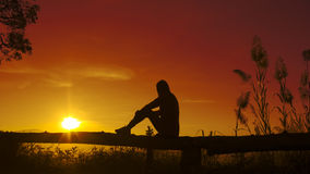 sunset-silhouette-young-woman-sad-alone-47516476